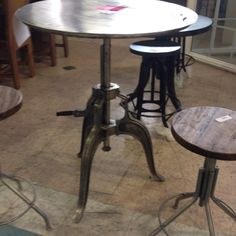 Unique pub table and stools. Great for a loft kitchen or fun outdoor space.