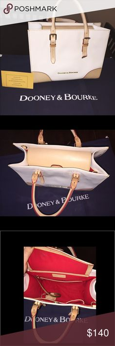 DOONEY & BOURKE PATENT LEATHER PURSE This GORGEOUS lightly used white, tan and red color way is still in 10/10 condition. Including a never used, still packaged strap, Dooney & Bourke purse registry and the original Dooney and Bourke bag that the purse came in. Dooney & Bourke Bags Satchels