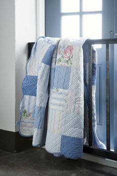 Country quilts over the railing