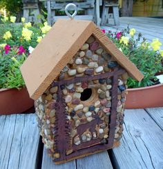 My primary objective is to use as many found, recycled and sustainable materials as possible in creating each birdhouse. They are unique, one of-a-kind items, with no two pieces being exactly alike. Stones used are collected from the shores of Lake Michigan, local rivers and from creek beds. Certain models may also contain, washed gravel, beach glass, recycled glass or recycled hardware.