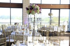 tall silver candelabras adorned with lavender, purple, and blush floral by AntebellumDesign.com