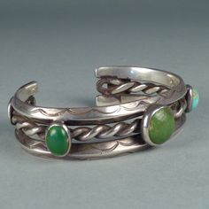 Stamped and Twisted Silver Wire Bracelet with Five Turquoise Stones, c.1920