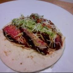 Campfire Carne Asada Tacos. Very easy entertaining recipe. If you can wield a food processor and a set of tongs, you are set. I always kick off the summer camping season by doing these over the campfire. The nice thing about this recipe is that you can do most everything beforehand, leaving you time to quaff a few with your buddies. Perfect for tailgating or camping where people stand while they eat.