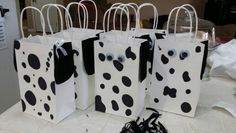 Hand made 101 dalmatian gift bags for my child's class. Could also be used for a themed birthday party.