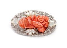 White gold, carved coral, mother-of-pearl and diamond brooch
