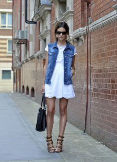 denim vest, white dress. With flats, no doubt another go-to school day outfit. i have a puffy vest...so dress with tights, sweater, boots and probably a beanie/scarf. Or no scarf and a bold necklace. Or add knee high socks or leg warmers.