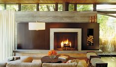 contemporary fireplace with board-formed concrete surround | 31st Street by Kirkpatrick Architects