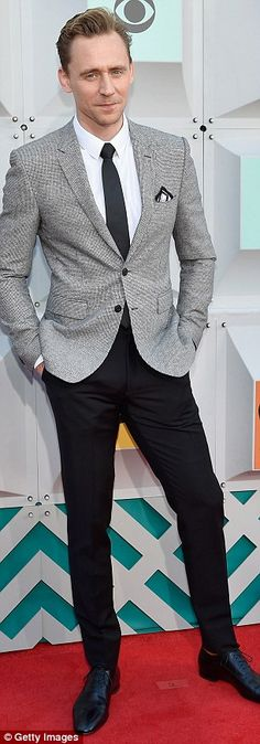 Dapper: Actor Tom Hiddleston looked impeccable in a grey blazer, black trousers and tie with a white shirt