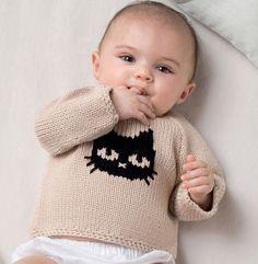 On adore ce modèle de pull brassière au motif chat. Modèle tricoté en 'Fil tendresse' coloris beige et noir au point jersey. Modèle n°12 du catalogue N°122 : Layette, Printemps/été 2015