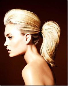 sleek high ponytail. For extra volume in the ponytail you can make TWO ponytails just above one another. Then take a smal section of hair, twist it around the two ponytails by the root to hide them, and secure with bobby pins