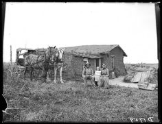 A family sits proudly outside of their modest sod home in Sartoria. Pioneer Day, Pioneer Life, Done With Life, American Spirit, Old Barns, Old West, Historical Photos, Nebraska, Trees To Plant