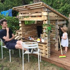 Pallet Furniture 15 adorable recycled pallet ideas for kids — ROWDY RASCALS - You are guaranteed to love this specially curated collection of up cycled pallet ideas for kids. Kids Outdoor Play, Outdoor Play Areas, Backyard For Kids, Recycled Pallets, Wooden Pallets, Recycled Materials, Pallet Playhouse, Kids Wooden Playhouse, Playhouse Ideas