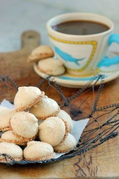 Ground almonds and a rich meringue make for delicious gluten-free cookies along side a cappuccino.