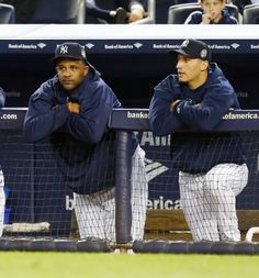 Andy Pettitte reconnects with old pal CC Sabathia at Yankees camp  -  March 7, 2017:   CC Sabathia #52 (L) and Andy Pettitte #46 of the New York Yankees look on from the dugout during the first inning against the Tampa Bay Rays at Yankee Stadium on Tuesday, September 24 2013 in the Bronx borough of New York City. Photo Credit: Jim McIsaac