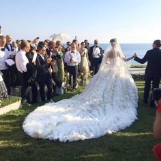 How to throw a #wedding like a fashion editor: make an entrance in several statement dresses including a couture Alexander McQueen #weddinggown with an endless train of ruffles. {Facebook and Instagram: The Wedding Scoop}