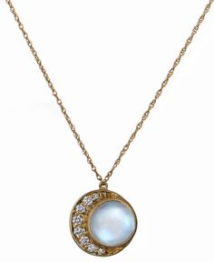 Full Moon necklace in 14k yellow gold with rainbow moonstone and diamonds, $1,390; Blackbird and the Snow