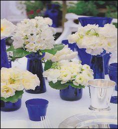 simple flowers in cobalt vases