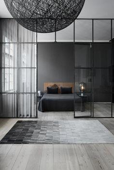 Minimalist bedroom interior with black wall