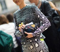 Rila Fukushima wearing our Spring '14 Panama hearts and lips print Adele shirt, Spring '14 Panama hearts and lips print Chris trousers, Spring '14 embroidered Falabella clutch  Photo by Adam Katz Sinding | Le 21ème.