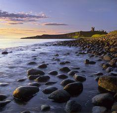 Dunstanburgh, Northumbria, England by Ian Cameron