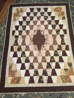 Tumbler quilt using brown and beige scraps. Quilted with embroidery machine. Pattern From Froggy's Quilts & Simple Pleasures. Strip Quilts, Panel Quilts, Patch Quilt, Scrappy Quilts, Vintage Quilts Patterns, Modern Quilt Patterns, Tumbling Blocks Quilt, Quilt Blocks, Tumbler Quilt