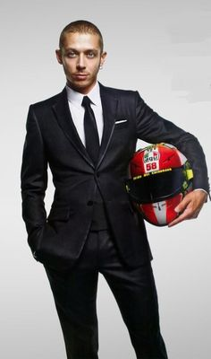Vale looking sharp in a suit. Also has a simoncelli tribute helmet. Vale has them designed specially ,wears them and auctions them. All the money goes to the simoncelli foundation for under privileged kids. Rock on Vale!