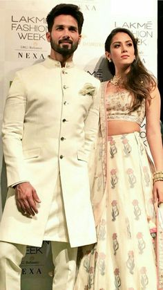Shahid Kapoor with wife Mira Rajput in classical white sherwani and floral lehenga.Get the outfit for Manufacturer rate call or WhatsApp at Mens Indian Wear, Mens Ethnic Wear, Indian Groom Wear, Indian Men Fashion, Wedding Dresses Men Indian, Wedding Outfits For Groom, Wedding Dress Men, Wedding Suits, Wedding Prep