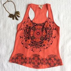 """LISTING Coral Print Tank Gorgeous and eye-catching bright coral racerback tank. Fun paisley and florals print. One tiny mark, not noticeable when wearing (shown in fourth picture). 26"""" long. 100% polyester. Machine wash. Route 66 Tops Tank Tops"""