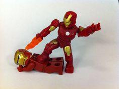 Mega Bloks Iron Man beats down Lego Iron Man.  (Photo Credit:  ShoTwice's Flickr account)