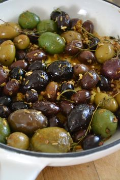 Roasted Olives - The citrus zest, fresh herbs, and whole spices give the olives a multi-layered flavor.  I like using whole spices so you get little explosions of intense taste depending on where you bite down.  The complex flavors linger in your mouth, which encourages you to eat slowly and deliberately.....