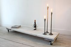 White Painted Reclaimed Scaffolding Boards Long Low Occasional Table/Bench on Castors - Its salvaged vintage industrial design works perfectly in a