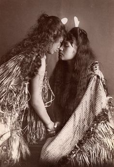 Maori women, New Zealand, c. 1900. They are doing a Hongi which is a touch of the noses. These is a greeting and also sign of respect.