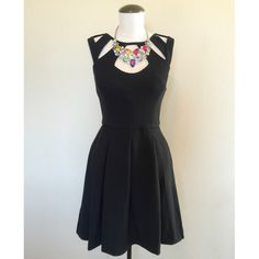 Betsey Johnson Cut-Out (Black) Dress sz 8 NWT Betsey Johnson High-Neck Cut-Out (Black) Dress sz 8 NWT▪️It's brand new, with tags, never been worn. It has a zipper up the back. The necklace is NOT included.                                    NO TRADES NO PAYPAL Betsey Johnson Dresses