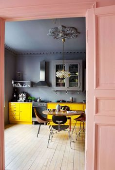 color-blocked pink, yellow and gray eat-in kitchen. / sfgirlbybay