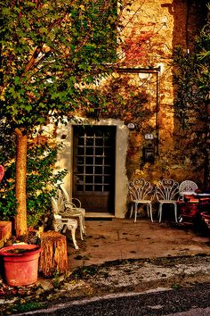 The village of Iano,  province of Florence , Tuscany region Italy - Don't you want to sit here with a cup of coffee and chat with friends and family!