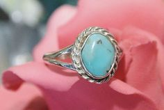 ITEM # 101431  Vintage unmarked sterling silver turquoise ring, size 7. The stone is attributed to the Dry Creek mine in Nevada. Some also