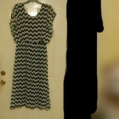 Chevron Dress Black dress with a black & white sheer Chevron patterned over dress.  It has rubber in the waist. The hem will need to be redone as it was defective at time of purchase. NWT  No size listed but measures:  26 inches armpit to armpit 54 inches long 23 inches with waist stretched Dresses