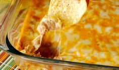 Texas Trash Warm Bean Dip is a must for your Super Bowl Party or any party. Open up a bag of tortilla chips and watch it disappear.