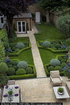 Backyard Idea  Topiary balls with a retreat patio
