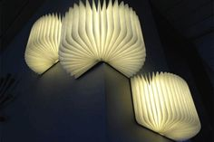 Portable light that folds up into a book and becomes illuminated when opened. Watch the video. I want this.