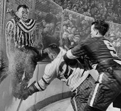 Gordie Howe of the Detroit Red Wings takes out Frank Udvari as the referee escapes collision. Olympia Stadium, Pirate History, Hockey Rules, Hockey World, Detroit News, Red Wings Hockey, Nhl Jerseys, Mystery Of History, Detroit Pistons