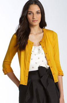 Love this Kate Spade ensemble featuring a bow skirt, subtle bee print, and tiny ruffles on the cuff of the Kimi Cardigan