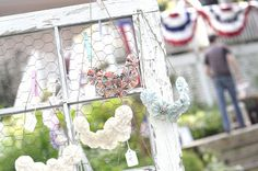"""""""accessorize your life!""""...YoYo Necklaces.  Window made with chicken wire display for shows #window #chicken wire"""