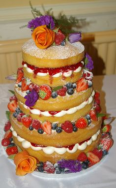 Naked Wedding Cake by Miss Rose's, decorated with fresh berries and flowers