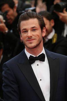 sleek brushed medium hairstyle for men