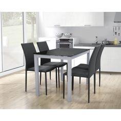 Conjunto de mesa con seis sillas para salón comedor o cocina. Es un conjunto de mesa metálica con estructura con recubrimiento cromado con tapa de cristal templado con circulos de acero termo-pegado en blanco o negro con seis sillas metálicas tapizadas.