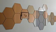 honeycomb mirror wall - available at Ikea. @ Home Improvement Ideas