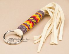 This is an authentic Native American handcrafted key chain. Made by Navajo Indians, it is a fabulous beaded key ring. This beautiful key chain is perfect as any southwest, western or Native style acce