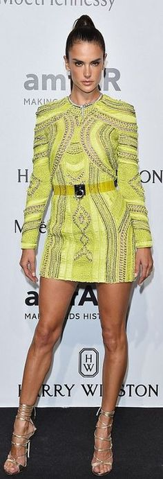Who made  Alessandra Ambrosio's yellow print dress, jewelry, and gold wrap sandals?