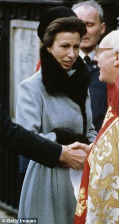 Second, at 29 years — this fur-lined blue coat is  filed under 'church outings, winter'. First, meeting a clerical dignitary with then husband Captain Mark Phillips in 1983 (left). Then it reappeared when she accompanied her son Peter Phillips and his wife Autumn to church last Christmas Day (right)